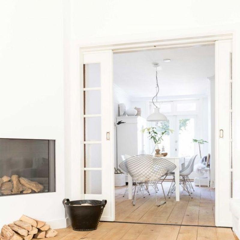 klassiek onderlopend witte schuifdeuren zitkamer