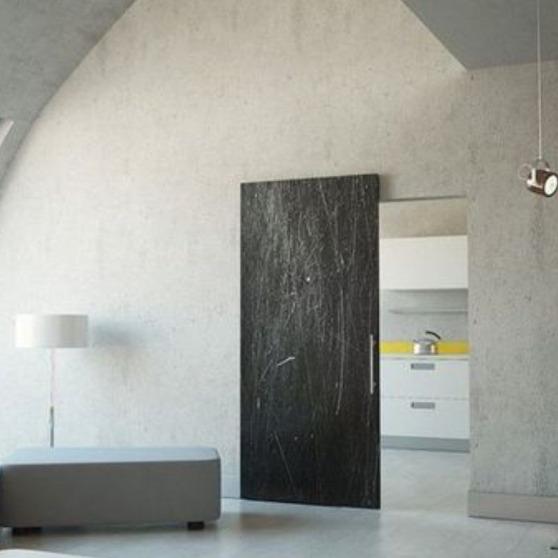 schuifdeur onzichtbaar beton woonkamer