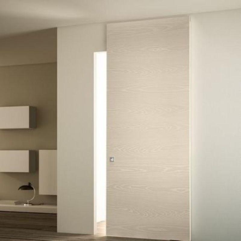 schuifdeur onzichtbaar design wit woonkamer