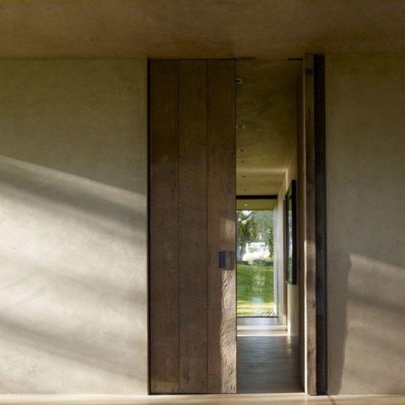 schuifdeur hout beton modern