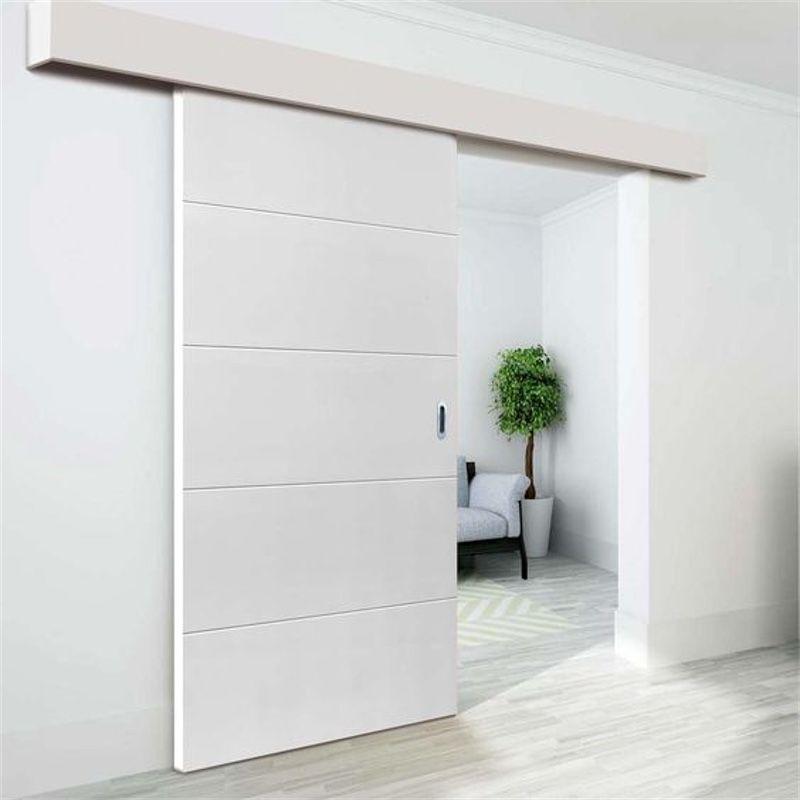 schuifdeur wit hangend voor wand woonkamer